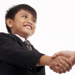 successful businessman handshaking to a business partner